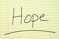 Ελπίδα σε ένα κίτρινο νομικό μαξιλάρι Στοκ Εικόνες
