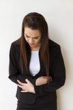 Εμμηνόρροια ή πόνος στομαχιών της επιχειρησιακής γυναίκας Στοκ Φωτογραφίες