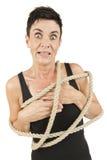 Εμπλεγμένο γυναίκα τρομαγμένο κοίταγμα στοκ φωτογραφία