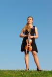 ενάντια στο βιολί στάσεων στοκ εικόνα