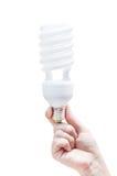 ενέργεια έννοιας - αποταμίευση Λάμπα φωτός εκμετάλλευσης χεριών γυναικών στο λευκό Στοκ Φωτογραφία
