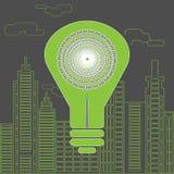 Ενέργεια - αποταμίευση lightbulb μπροστά από τους ουρανοξύστες Στοκ εικόνα με δικαίωμα ελεύθερης χρήσης