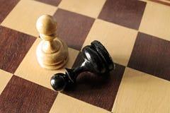 Ενέχυρα σε ένα χαρτόνι σκακιού Στοκ Εικόνα