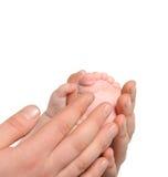 ενήλικα χέρια ποδιών μωρών Στοκ Φωτογραφία