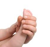 ενήλικα χέρια ποδιών μωρών Στοκ φωτογραφία με δικαίωμα ελεύθερης χρήσης