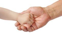 ενήλικο χέρι s παιδιών Στοκ Εικόνες
