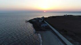Εναέρια άποψη του ηλιοβασιλέματος πέρα από το νερό Στοκ Φωτογραφίες
