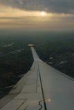 Εναέρια εικόνα wingtip, ήλιος και γη Στοκ Φωτογραφία