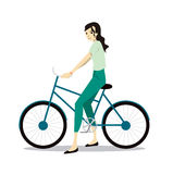 Ενεργός νέα γυναίκα που οδηγά στο ποδήλατο ελεύθερη απεικόνιση δικαιώματος