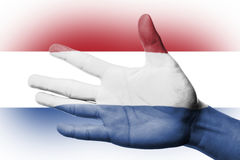 Ενθαρρυντικός ανεμιστήρας με τη ζωγραφική της εθνικής ολλανδικής σημαίας Στοκ φωτογραφίες με δικαίωμα ελεύθερης χρήσης