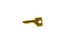 Ενιαίο κίτρινο κλειδί που απομονώνεται στο λευκό Στοκ φωτογραφίες με δικαίωμα ελεύθερης χρήσης