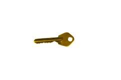 Ενιαίο κίτρινο κλειδί που απομονώνεται στο λευκό Στοκ φωτογραφία με δικαίωμα ελεύθερης χρήσης