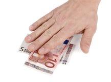 Ενιαίο χέρι στα ευρο- τραπεζογραμμάτια που απομονώνονται Στοκ Φωτογραφίες