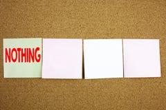 Εννοιολογική έμπνευση τίτλων κειμένων γραψίματος χεριών που παρουσιάζει σε τίποτα επιχειρησιακή έννοια για την αντίφαση τίποτα απ στοκ φωτογραφία