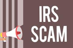 Εννοιολογικό χέρι που γράφει παρουσιάζοντας απάτη IRS Επιχειρησιακή φωτογραφία που επιδεικνύει τους στοχοθετημένους φορολογούμενο στοκ φωτογραφίες