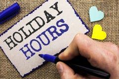 Εννοιολογικό χέρι που γράφει παρουσιάζοντας διακοπές ώρες Έξτρα χρόνος Openi πωλήσεων χρονικών εποχιακός μεσάνυχτων εορτασμού επί Στοκ Εικόνες