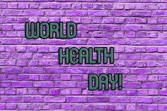 Εννοιολογικό χέρι που γράφει παρουσιάζοντας ημέρα παγκόσμιας υγείας Σφαιρική ημέρα συνειδητοποίησης υγείας κειμένων επιχειρησιακώ στοκ εικόνα