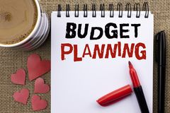 Εννοιολογικό χέρι που γράφει παρουσιάζοντας προγραμματισμό προϋπολογισμών Επιχειρησιακή φωτογραφία που επιδεικνύει την οικονομική στοκ εικόνες