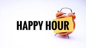 Εννοιολογική εικόνα της επιχειρησιακής έννοιας με την ευτυχή ώρα λέξεων σε ένα ρολόι με ένα άσπρο υπόβαθρο Εκλεκτική εστίαση Στοκ Εικόνες