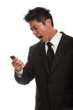 Ενοχλημένο ασιατικό άτομο που φωνάζει στο τηλέφωνό του Στοκ φωτογραφίες με δικαίωμα ελεύθερης χρήσης