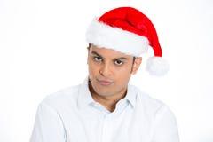 , Ενοχλημένο άτομο στο κόκκινο καπέλο santa Στοκ φωτογραφίες με δικαίωμα ελεύθερης χρήσης