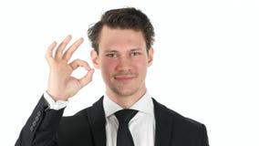 Εντάξει σημάδι από το νέο επιχειρηματία στο άσπρο υπόβαθρο Στοκ εικόνες με δικαίωμα ελεύθερης χρήσης
