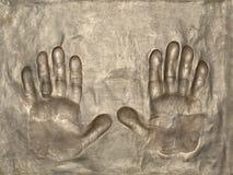 εντύπωση χεριών χαλκού Στοκ εικόνα με δικαίωμα ελεύθερης χρήσης