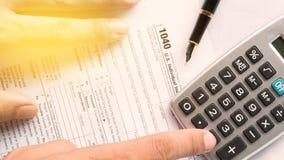 Ενωμένο κράτος 1040 μεμονωμένο φορολογική έντυπο φορολογικής δήλωσης με τη μάνδρα Στοκ Φωτογραφία