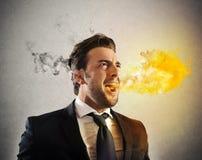 Εξαγριωμένη spitting επιχειρηματιών πυρκαγιά Στοκ Φωτογραφία