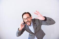 Εξαγριωμένο άτομο που μιλά στο τηλέφωνο Στοκ φωτογραφία με δικαίωμα ελεύθερης χρήσης