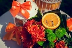 Εξαρτήματα και διακόσμηση για τον πορτοκαλή γάμο σας Στοκ Φωτογραφία
