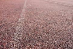 Εξασθενίστε τη διαδρομή φυλών τρεξίματος και την άσπρη γραμμή Στοκ εικόνα με δικαίωμα ελεύθερης χρήσης