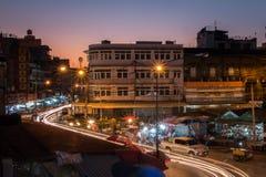 Εξασθενίστε το ηλιοβασίλεμα με την αγορά στοκ φωτογραφία