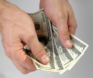 εξετάστε τα χρήματα Στοκ εικόνα με δικαίωμα ελεύθερης χρήσης