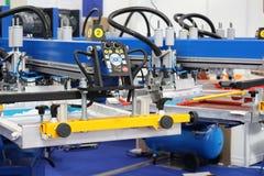 Εξοπλισμός για στα κλωστοϋφαντουργικά προϊόντα Αυτόματος Τύπος εκτύπωσης στοκ εικόνα με δικαίωμα ελεύθερης χρήσης