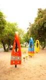 Εξοπλισμός παιδικών χαρών σε μια ισοτιμία Στοκ Φωτογραφίες