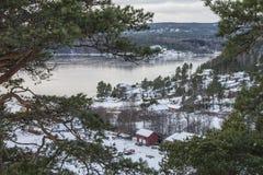 Εξοχικά σπίτια από το Iddefjord Στοκ Εικόνες