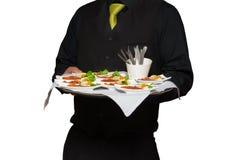 Εξυπηρετώντας τρόφιμα σερβιτόρων Στοκ Φωτογραφία
