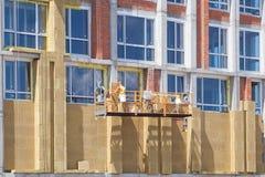 Εξωτερικό σύστημα μόνωσης τοίχων ή ορυκτό μαλλί EWIS για την ενέργεια - αποταμίευση Στοκ εικόνα με δικαίωμα ελεύθερης χρήσης