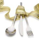 εορταστικό κουτάλι κορδελλών μαχαιριών δικράνων που εμπλέκεται Στοκ Εικόνες