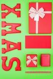 Εορταστικό πρότυπο Χριστουγέννων στα κόκκινα και πράσινα χρώματα Στοκ Εικόνες