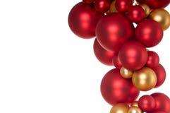 εορταστικό χρυσό κόκκινο διακοσμήσεων Στοκ Εικόνες