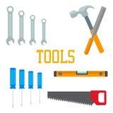 Επίπεδα εργαλεία Σφυρί, σμίλη πριονιών κατσαβιδιών, γαλλικό κλειδί με την εγγραφή του οργάνου Στοκ Εικόνες