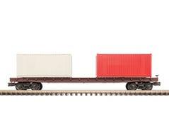 Επίπεδο αυτοκίνητο σιδηροδρόμου με τα εμπορευματοκιβώτια στοκ εικόνες