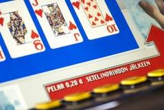 Επίδειξη μηχανημάτων τυχερών παιχνιδιών με κέρματα, κάρτες παιχνιδιού Στοκ Εικόνες