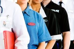 Επαγγέλματα: Ανώνυμη ομάδα ανθρώπων στις διάφορες εργασίες Στοκ Φωτογραφίες