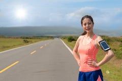 Επαγγελματικό θηλυκό jogger που φορά την αθλητική ενδυμασία Στοκ Εικόνες