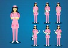 Επαγγελματικό νέο ροζ γυναικών τρίβει τις νοσοκόμες ελεύθερη απεικόνιση δικαιώματος