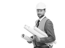 Επαγγελματικός αρσενικός επιχειρηματίας κατασκευής με τα σχεδιαγράμματά του Στοκ Φωτογραφία