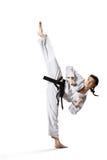 Επαγγελματικός θηλυκός karate μαχητής που απομονώνεται επάνω Στοκ Φωτογραφία